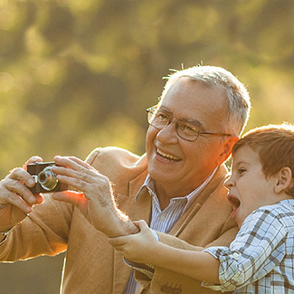 Grandfather taking photo with grandson